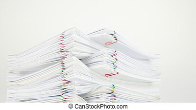 Pile of document overload with colorful paperclip time lapse...