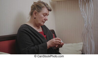 An elderly woman with medications. Pill in home
