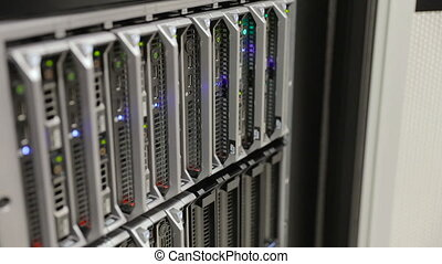 IT technician replace harddrive at blade server in...