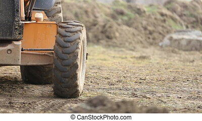 bulldozer transports the ground - bulldozer shovel carries...