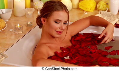 Girl taking bath with rose petals. - Sensual tender sexy...