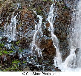 Waterfalls among Rocks at Xyliatos dam in Cyprus - Water...