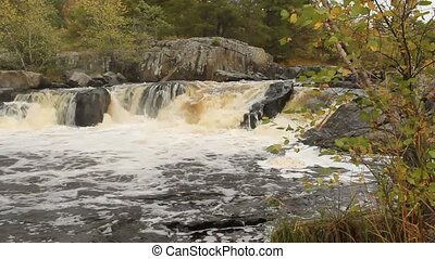 River flowing waterfall - River flowing into a waterfall in...