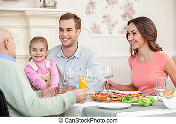 Mature man is dining with his relatives - Portrait of...