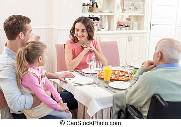 Pretty family has a lunch together - It is great to dine...