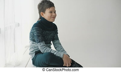 Fashion shot of a young man in a sweater. Smile