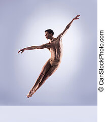 Athletic ballet dancer in a perfect shape performing over...