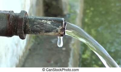 Spring water pouring from a pipe - Natural spring water...