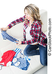 Young expectant mother bought childrens wear - Young...