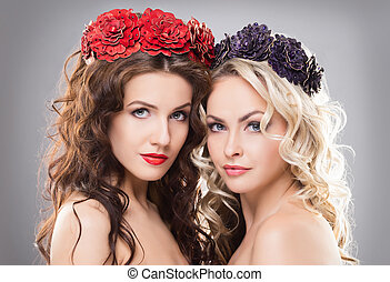 Close-up of two absolutely gorgeous and glamorous women...