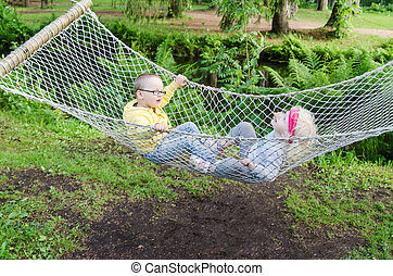 Children swinging in a hammock