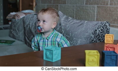 A kid playing toy blocks at home