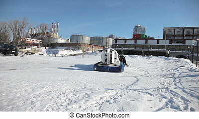 Hovercraft on the ice of the bank of frozen Volga River in...