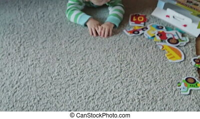 Cute baby boy crawling on the floor
