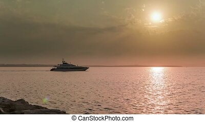 Superyacht sailing into the sunset.