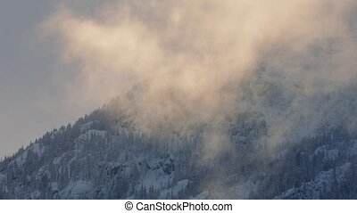 Mist Rises Over Mountain In Evening