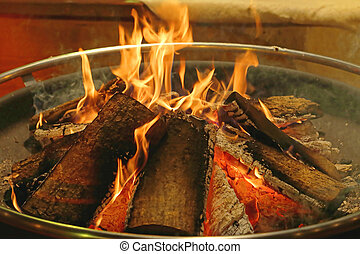 Log Fire in Circular Metal Firepit Tray