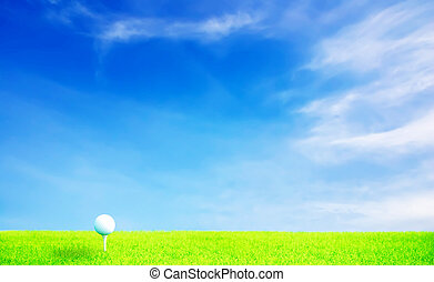 Golf ball on grass under blue sky and clouds with high light...