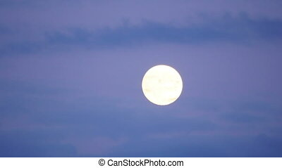 quot;full moon timelapse with clouds at twilight, zoom out,...