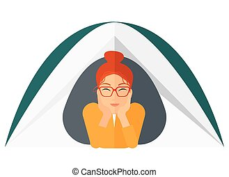 Woman lying in tent - A woman crawling out from a tent...