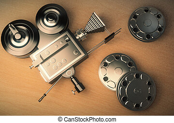 Top view of an old movie camera and film cartridge on a...