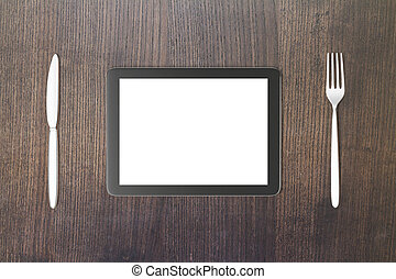 Gadget concept with blank digital tablet screen with fork...