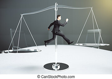 Balance concept with businessman tries to keep his balance...