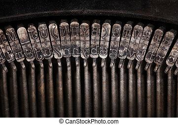 Types of vintage typewriter close-up, warm filter