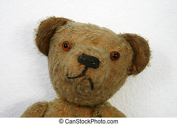 Old stuffed Teddybear rag doll - Close up of an old stuffed...