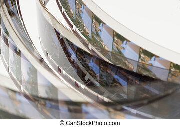 Old positive 16 mm film strip on white background, strip of...