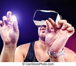 Man uses Virtual Realitiy VR head-mounted display - Man has...