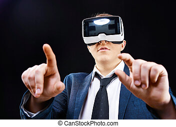 Businessman uses Virtual Realitiy VR head-mounted display -...