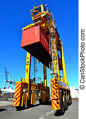 Straddle carriers and containers on Fergusson Wharf at Ports...