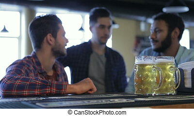 Three men with beer rejoice the victory of team - People,...