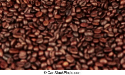 top of view of texture of roasted coffee beans with initial...