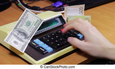 Businessman Counting On a Old Calculator - Businessman...