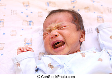Newborn baby of asia crying on white bed. - Newborn baby of...