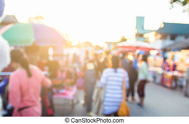 abstract blur background of people shopping at market fair...
