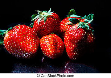 Strawberries on Black - Contrasty shot of strawberries on a...