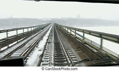 Train moves on the bridge across the river. Traveling by...