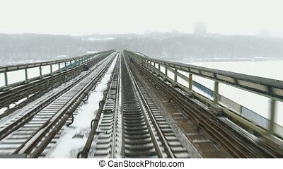 Transportation by rail. Movement of trains on winter bridge....