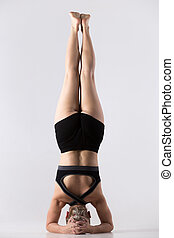 Headstand, Salamba Sirsasana - Sporty beautiful young woman...