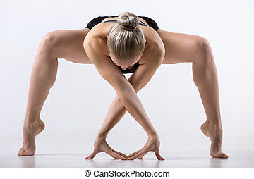 Forward bending Sumo Squat Pose - Sporty beautiful young...