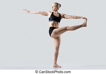 Twisting Extended Hand to Big Toe - Sporty beautiful young...