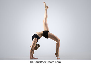 One-legged Bridge Pose - Sporty beautiful young woman...