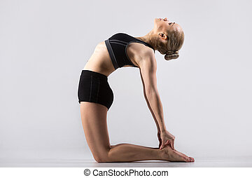 Ustrasana Pose - Sporty beautiful young woman practicing...
