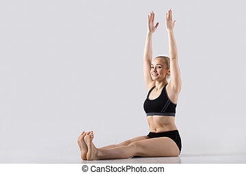 Dandasana yoga Pose - Sporty happy beautiful young woman...