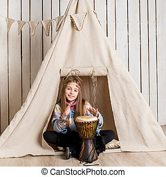 little girl near wigwam playing Indian - little girl with...