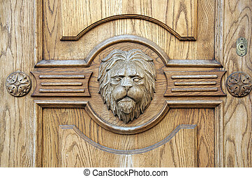 Lion fragment ancient carved door