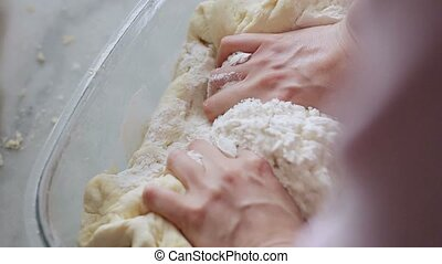 Woman kneading dough.